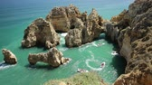 kolumny : Aerial view of scenic landscape of boat trip between cliffs and natural rock formations of Ponta da Piedade in Lagos, Algarve, Portugal. Summer holidays. Tour tourism in Atlantic Ocean. Sunny day.