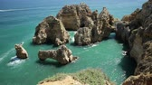 sea caves : Tourism in Algarve. POV looking at amazing views of Ponta da Piedade promontory. Enjoying iconic cliffs of Lagos. Summer holidays in Portugal, Europe. Stock Footage