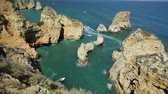 pilíře : Summer holidays in Algarve, Portugal. Touristic boat trip in Ponta da Piedade and overlooks the coast of Lagos with iconic cliffs and limestone. Turquoise sea, sunny day.