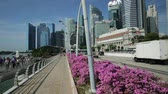 fullerton : Singapore - April 28, 2018: Singapore downtown skyline with Fullerton Hotel, skyscrapers of Business District or CBD buildings and Esplanade Bridge in Marina Bay Promenade. Sunny day blue sky.