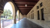 kurum : Palo Alto, California, United States - August 13, 2018: POV walking in the Pigott Hall archway of Stanford University of Silicon Valley, San Francisco Bay area.