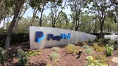 caído : San Jose, California, United States - August 12, 2018: Paypal sign at Paypal HQ. Paypal is a multinational corporation that provides a virtual bank service and payments for internet business.