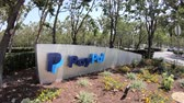 caído : San Jose, California, United States - August 12, 2018: Paypal Headquarters logo, a multinational corporation that provides a virtual bank service and payments through internet Stock Footage