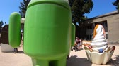 google campus : Mountain View, CA, United States - August 13, 2018: Android ice cream statue at Googles Merchandise Store and Google Visitor Center Beta. Android lawn are a popular place for selfies.