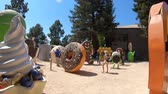 google campus : Mountain View, CA, United States - August 13, 2018: Android ice cream and donuts statues at Googles Merchandise Store and Google Visitor Center Beta. Android lawn are a popular place for selfies. Stock Footage