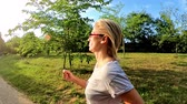 zadnice : Slow motion of fitness woman in sportswear running on the grass of an urban park in Bologna city of Italy Side view in rallenty moving. Healthy lifestyle concept.