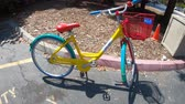 google campus : Mountain View, California, United States - August 13, 2018: detail of colorful Googles Bike outside the Google Store of Silicon Valley. Gadget and branded souvenirs are sold in the shop.