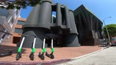 google campus : Los Angeles, California, United States - August 21, 2018: bird and lime electric scooters in front of Binocular Building Google HQ. Googles Los Angeles office in Venice, 340 Main Street, Santa Monica Stock Footage