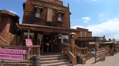 main street : Calico, CA, USA - August 15, 2018: Sweets Shoppe in main street of Cowboy Theme Park, Yermo.Calico was designated Silver State Rush Ghost Town of California near Barstow, San Bernardino County. Stock Footage