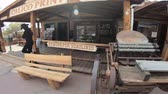 main street : Calico, CA, USA - August 15, 2018: Calico print shop in main street of Cowboy Theme Park, Yermo.Calico was designated Silver State Rush Ghost Town of California near Barstow, San Bernardino County. Stock Footage