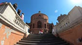 emilia : Bologna, Italy - September 29, 2018: tourists taking pictures on the stairway of Holy Mary of San Luca church in Bologna on holiday.