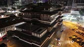 реликвия : Buddha Tooth Relic Temple of Singapore from aerial view, Southeast Asia. Spectacular buddhist temple in Chinatown district with business district skyline on background by night.