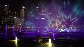 fountain show : Singapore - April 26, 2018: the Spectra: Light and Water Show at Event Plaza along promenade in front of Marina Bay Sands. The show of dancing fountains is a popular tourist attraction of Singapore.