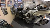 dodge : San Diego, California, USA - August 2, 2018: Classic Highway Patrol Police motorcycle of 1980s at historic police museum. Sheriffs Museum of Old Town of San Diego. Stock Footage