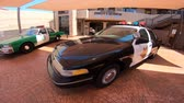 police officers : San Diego, California, USA - August 2, 2018: Classic Ford Crown Victoria Police Interceptor car of 1980s at Sheriffs Museum of Old Town of San Diego.