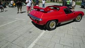red square : Cascais, Portugal - August 6, 2017: historic Lotus Europa S2 car of red color with a rear flap in the vintage cars show in historic Cascais town center.