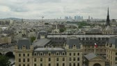 brim : Panoramic cityscape aerial of Paris in France with the Tour Eiffel tower and Pont Saint-Michel bridge on Senna river, from Notre Dame of Paris church in France. Stock Footage