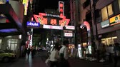 dotonbori : Osaka, Japan - April 29, 2017: bright neon of Dotonbori sign at entrance in Dotonbori street, Namba District. It is one of the principal tourist destinations in Osaka, Japan. Night scene. Stock Footage