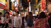 dotonbori : Osaka, Japan - April 29, 2017: Japanese elegant people walking and shopping at night in Dotonbori district of Osaka, Japan. Night urban scene. Stock Footage