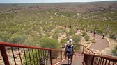 gözcü : Blonde caucasian woman descending the gorge from top trail to popular Natures Window in Kalbarri National Park. Backpacker female travel in the outback of Western Australia. Stok Video