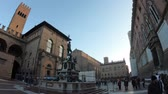 emilia : Bologna, Italy - December 7,2018:Architecture panorama of Bologna city. Neptune bronze statue and restored fountain, with historic orange-red buildings background in Nettuno square of the town center.