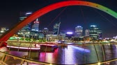 elizabeth : Panorama of coloful arcade and illuminated walkway of Elizabeth Quay Bridge by night at Elizabeth Quay Marina in Perth, Western Australia. Central business district reflecting on Swan River.