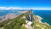 linea : Panorama of top of Gibraltar Rock, in Upper Rock Natural Reserve: on the left Gibraltar town and bay, La Linea town in Spain at the far end, Mediterranean Sea on the right. United Kingdom, Europe.
