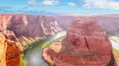 gözcü : Horseshoe Bend of Colorado River near Page town in Arizona, United States. Downstream from the Glen Canyon Dam and Lake Powell within Glen Canyon National recreation area, Grand Canyon at Lake Powell. Stok Video