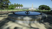 örök : Perth, Australia - Jan 3, 2018: Eternal flame of Remembrance and Pool of Reflection with the State War Memorial behind on Mount Eliza in Kings Park. Perth cityscape on background. blue sky