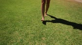 elizabeth : Happy woman walking barefoot on the park grass of Perth city, Western Australia. Outdoors activities. Concept of ecology, freedom and nature.