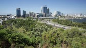 gözcü : Kings Park overlooking Perth Water, a section of Swan River, and central business district of Perth from the most popular visitor destination in Western Australia. Blue sky. Perth skyline aerial view. Stok Video