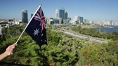 hattyú : Australian flag waving over Perth Water, a section of Swan River, and central business district of Perth from Kings park, the most popular visitor destination in WA. Blue sky. Perth skyline aerial
