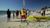 구조 : Cottesloe, Western Australia - Jan 2, 2018: lifeguard placing a no-swimming sign for a shark sighting at Cottesloe Beach in the Perths most famous town beach in the Indian Ocean.