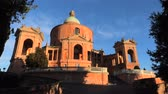 emilia : Pronaos and facade of the Sanctuary of Madonna di San Luca at sunset. Basilica church of San Luca in Bologna, Emilia-Romagna, Italy with blue sky. Famous landmark cityscape. Stock Footage