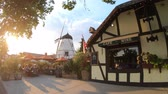 danimarka : Solvang, California, United States - August 10, 2018: people at a coffee shop enjoy picturesque Danish architecture of Solvang. Old Windmill at sunset. Santa Ynez Valley in Santa Barbara County.