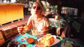enchilada : SLOW MOTION: Joyful blonde woman puts nachos chips in chili sauce, at typical Mexican food, in traditional restaurant of El Pueblo, Los Angeles Downtown State Historic Park, California, United States. Stock Footage