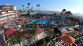 San Diego, California, United States - August 1, 2018: aerial view of swimming pool at historic Victorian Coronado Hotel on Pacific Ocean, a beachfront luxury resort, Coronado Island. Summer holidays.