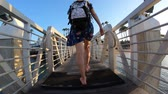 caído : Happy tourist woman walking on waterfront pier of Coronado Island. San Diego bay in California, United States. Travel and tourism american concept. Stock Footage
