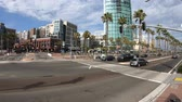 дорожный знак : San Diego, California, United States - July 31, 2018: crossing between Harbor Drive and San Diego Trolley and between Marina district and Gaslamp. Skyscrapers and Victorian buildings on background. Стоковые видеозаписи