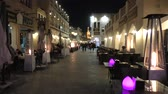 night scene : Doha, Qatar - February 17, 2019: historic buildings with traditional restaurants at Souq Waqif in central street, the old market in Doha, popular tourist attraction. Night scene.
