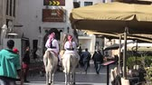 Doha, Qatar - February 20, 2019: Police on horse at Souq Waqif riding white Arabian Horses. Popular tourist attraction in Middle East, Arabian Peninsula. Vídeos