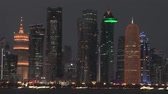 Doha West Bay skyline lighting by night in Doha Bay. Modern skyscrapers of Doha in Qatar, Middle East, Arabian Peninsula in Persian Gulf. Night urban scene.