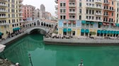 Doha, Qatar - February 20, 2019:Venetian Rialto bridge on canals of district of Doha. Venice at Qanat Quartier in the Pearl-Qatar, Persian Gulf, Middle East. Famous tourist attraction.