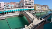 Doha, Qatar - February 20, 2019:panoramic bridge in Venice at Qanat Quartier in the Pearl, Middle East at sunset. Aerial view picturesque and luxurious district icon of Doha in venetian style in Qatar