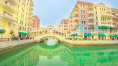 oriente médio : Doha, Qatar - February 20, 2019: TIME LAPSE view of Venice Rialto bridge replica at Qanat Quartier in the Pearl-Qatar, Persian Gulf, Middle East. Venetian bridge on canals Vídeos