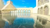 refletindo : Doha, Qatar - February 16, 2019: TIME LAPSE in courtyard of Museum of Islamic Art with fountains and arched windows opening view on Doha West Bay and Persian Gulf reflecting in a pool.