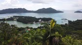 gözcü : Relaxing lookout of Praslin inside Reserve of Fond Ferdinand. Scenic view from top view of Praslin on Bay of St. Anne. Amazing views of Seychelles and Indian Ocean. Stok Video