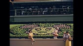 monorail : Orlando, Florida, United States - Circa 1979: Historical entrance of Magic Kingdom of Walt Disney World in Orlando city. United States of America 1979. Tourists by the flowered signboard. Stock Footage