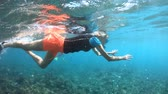 apnee : SLOW MOTION: Girl in bikini in apnea at Seychelles. Travel lifestyle watersport activity. Young caucasian woman snorkeling with tropical fishes. Woman free diving in Felicite Island coral reef