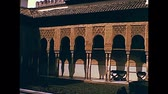 GRANADA, SPAIN - CIRCA 1974: The fountains and archways in courtyard of Alhambra Royal Palace. Historical archival of Granada city of Spain in 1970s.